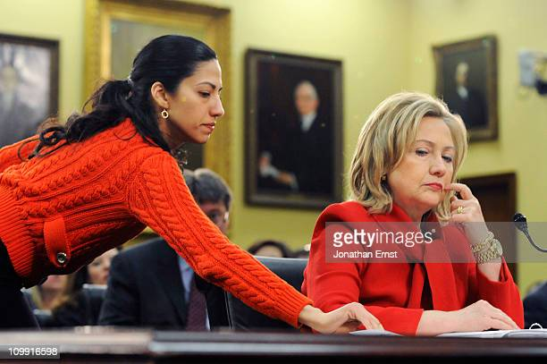 S Secretary of State Hillary Clinton receives a note from her aide Huma Abedin as she testifies about the State Department's FY2012 budget during a...