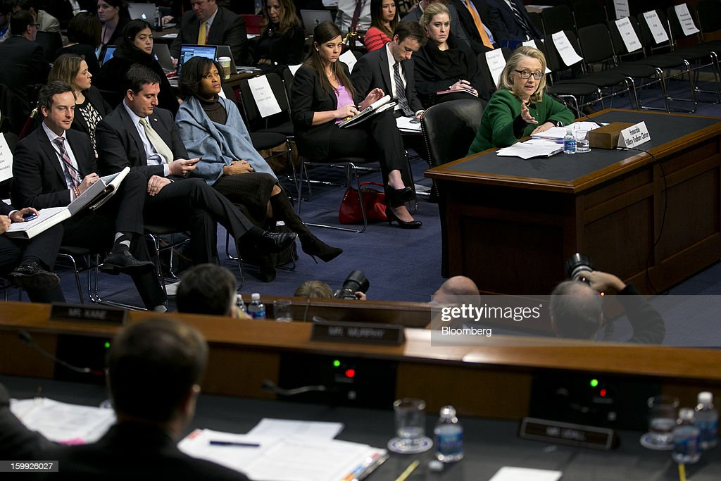 U.S. Secretary of State <a gi-track='captionPersonalityLinkClicked' href=/galleries/search?phrase=Hillary+Clinton&family=editorial&specificpeople=76480 ng-click='$event.stopPropagation()'>Hillary Clinton</a>, right, speaks during a Senate Foreign Relations Committee hearing in Washington, D.C., U.S., on Wednesday, Jan. 23, 2013. Clinton said she is moving quickly to correct the kinds of lapses in diplomatic security that left American diplomats vulnerable in the September attack on the U.S. mission in Benghazi, Libya. Photographer: Andrew Harrer/Bloomberg via Getty Images