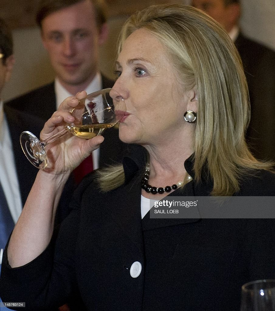 US Secretary of State Hillary Clinton samples wine in a wine cellar prior to dinner at Adjarian Wine House in Batumi on June 5, 2012. AFP PHOTO / POOL / Saul LOEB