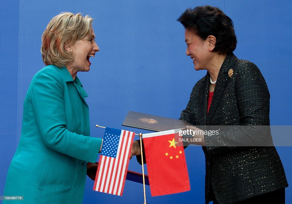 Secretary of State Hillary Clinton shakes hands with Chinese State Councilor Liu Yandong (R) after signing the US-China Consultation on People-to-People Exchange agreement at the National Center for the Performing Arts in Beijing on May 25, 2010. The United States and China were wrapping up strategic talks aimed at smoothing out differences on currency and trade issues, as Washington presses Beijing to get tough on North Korea. AFP PHOTO / POOL / Saul LOEB