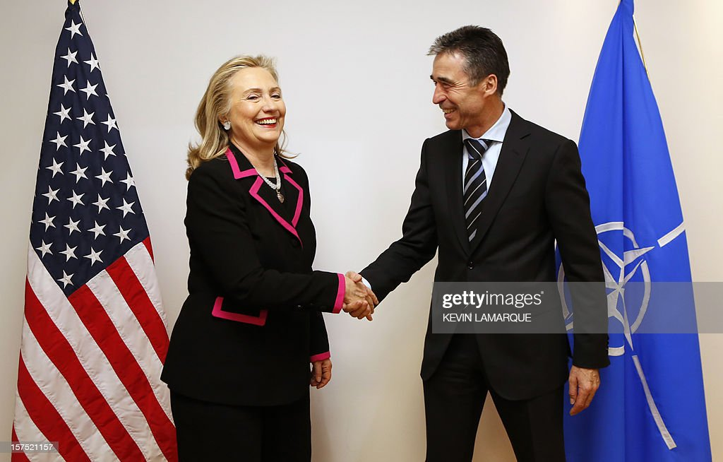 US Secretary of State Hillary Clinton (L) shakes hands with North Atlantic Treaty Organization (NATO) Secretary-General Anders Fogh Rasmussen on December 4, 2012 before a meeting of foreign ministers from the 28 NATO member-countries at organization headquarters in Brussels to discuss Syria and Turkey's request for Patriot missiles to be deployed protectively on the Turkish-Syrian border. .