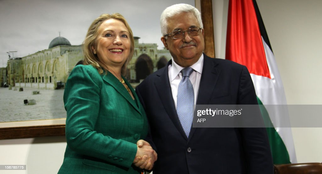 US Secretary of State Hillary Clinton (L) shakes hands with Palestinian president Mahmud Abbas during their meeting in the West Bank city of Ramallah on November 21, 2012. Fighting raged on both sides of Gaza's borders despite intensified efforts across the region to thrash out a truce to end a week of violence that has cost 136 Palestinian and five Israeli lives. Diplomatic efforts have involved US Secretary of State Hillary Clinton, UN chief Ban Ki-moon and Egyptian President Mohamed Morsi but a deal to end Israel's offensive on rocket-firing militants in the Gaza Strip remains elusive.