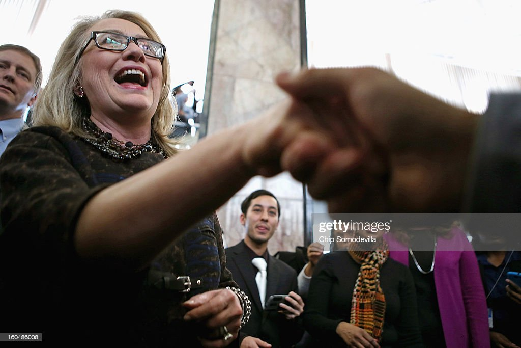 U.S. Secretary of State <a gi-track='captionPersonalityLinkClicked' href=/galleries/search?phrase=Hillary+Clinton&family=editorial&specificpeople=76480 ng-click='$event.stopPropagation()'>Hillary Clinton</a> shakes hands with people after her farewell address to the staff in the C Street lobby of the State Department on February 1, 2013 in Washington, DC. Clinton is leaving the State Department and the Obama Administration after travling 956,733 miles and visiting some 112 countries.She will be replaced by U.S. Sen. John Kerry (D-MA).