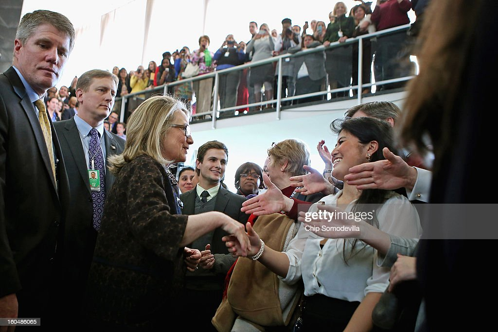 U.S. Secretary of State <a gi-track='captionPersonalityLinkClicked' href=/galleries/search?phrase=Hillary+Clinton&family=editorial&specificpeople=76480 ng-click='$event.stopPropagation()'>Hillary Clinton</a> (3rd L) shakes hands with people after her farewell address to the staff in the C Street lobby of the State Department on February 1, 2013 in Washington, DC. Clinton is leaving the State Department and the Obama Administration after travling 956,733 miles and visiting some 112 countries.She will be replaced by U.S. Sen. John Kerry (D-MA).