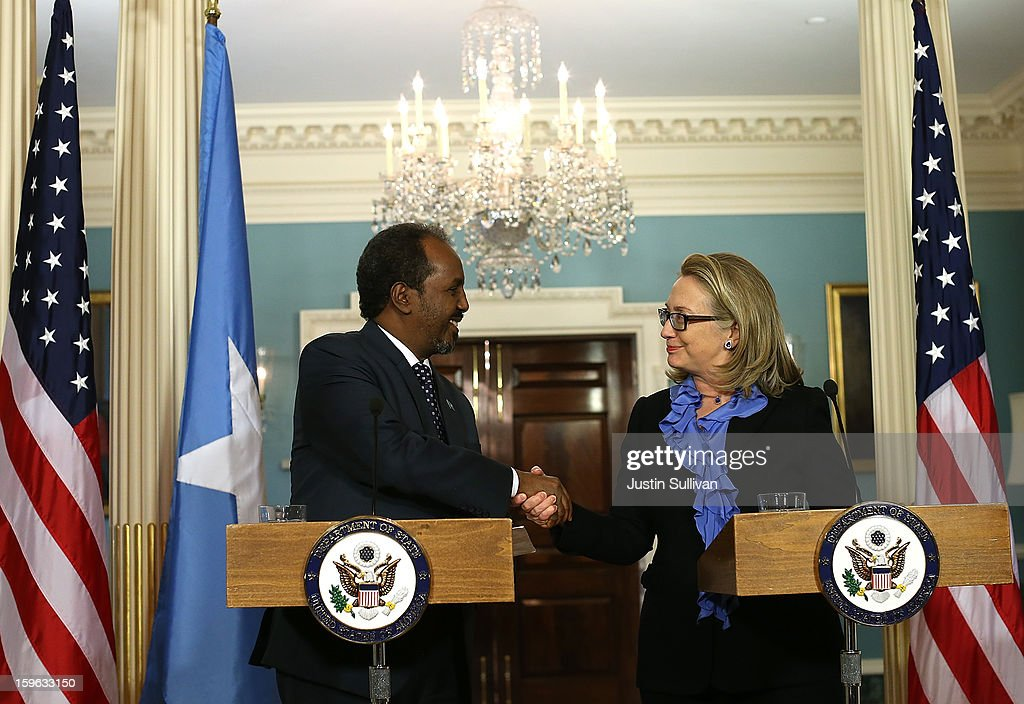 Secretary of State <a gi-track='captionPersonalityLinkClicked' href=/galleries/search?phrase=Hillary+Clinton&family=editorial&specificpeople=76480 ng-click='$event.stopPropagation()'>Hillary Clinton</a> (R) shakes hands with Somali president Hassan Sheikh Mohamud during a news conference on January 17, 2013 in Washington, DC. Secretary Clinton announced that the United States would recognize the Somali government for the first time in over 20 years, since the shooting down in Mogadishu of two American Black Hawk helicopters.