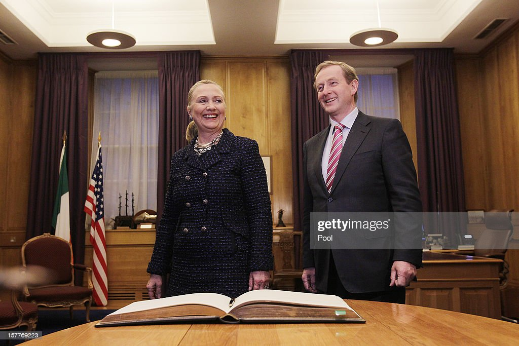U.S. Secretary of State Hillary Clinton (L) signs the visitors book in Taoiseach Enda Kenny's office before their press conference during the 19th Ministerial Council of the Organization for Security and Co-operation in Europe (OSCE) December 6, 2012 in Government Buildings, Dublin, Ireland. Clinton joined Russian Foreign Minister Sergey Lavrov and the U.N. and Arab League Envoy to Syria Lakhdar Brahimi on the sidelines of the event to address the worsening situation in Syria.