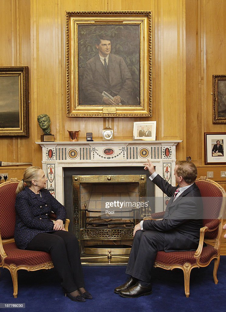 U.S. Secretary of State Hillary Clinton (L) sits under a portrait of Michael Collins in Taoiseach Enda Kenny's office before their press conference during the 19th Ministerial Council of the Organization for Security and Co-operation in Europe (OSCE) December 6, 2012 in Government Buildings, Dublin, Ireland. Clinton joined Russian Foreign Minister Sergey Lavrov and the U.N. and Arab League Envoy to Syria Lakhdar Brahimi on the sidelines of the event to address the worsening situation in Syria.