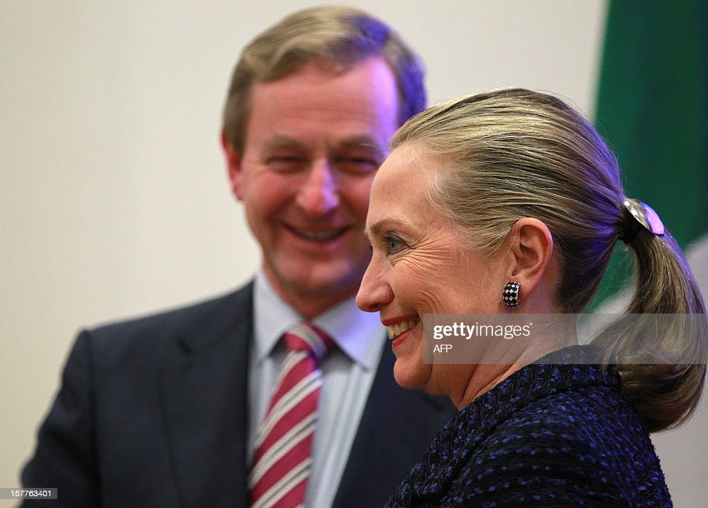 US Secretary of State <a gi-track='captionPersonalityLinkClicked' href=/galleries/search?phrase=Hillary+Clinton&family=editorial&specificpeople=76480 ng-click='$event.stopPropagation()'>Hillary Clinton</a> (R) smiles as Irish Prime Minister Enda Kenny (L) listens during a brief press conference at the Government buildings in Dublin, Ireland on December 6, 2012. Clinton on December 6 issued a sharp warning to European and central Asian nations that some countries were backsliding on democratic values and human rights. AFP PHOTO / PETER MUHLY