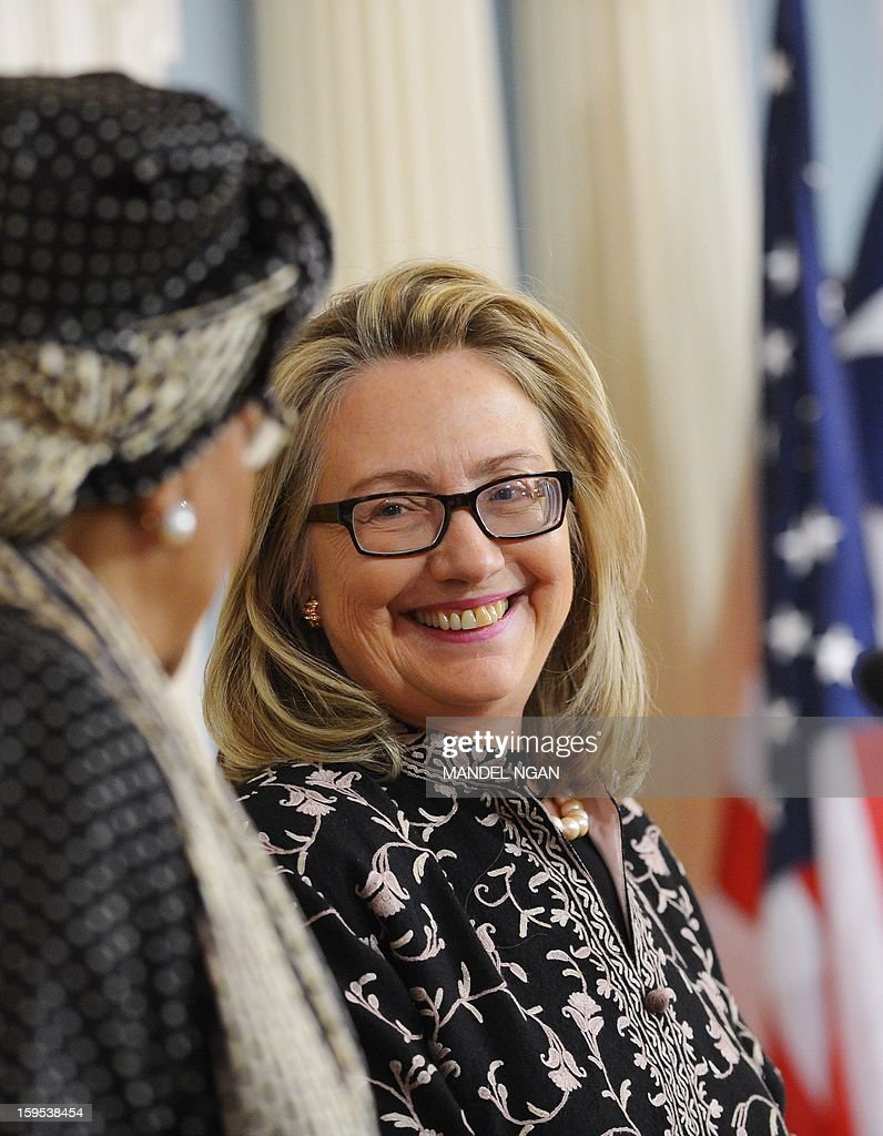 US Secretary of State Hillary Clinton smiles while speaking to the press with Liberian President Ellen Sirleaf Johnson following a bilateral meeting at the State Department January 15, 2013 in Washington, DC. AFP PHOTO/Mandel NGAN