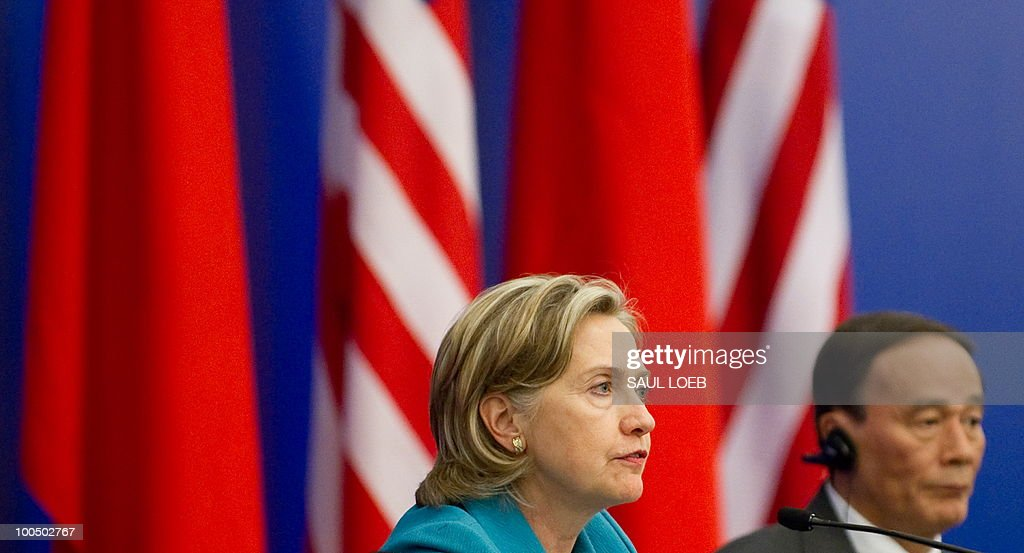 US Secretary of State Hillary Clinton speaks alongside Chinese Vice-Premier Wang Qishan during a signing ceremony at the conclusion of the Second Round of the US-China Strategic & Economic Dialogue in Beijing, May 25, 2010. US Secretary of State Hillary Clinton said two days of high-level Sino-US talks had been 'very productive' but admitted differences remained, especially on economic and trade issues. AFP PHOTO / POOL / Saul LOEB