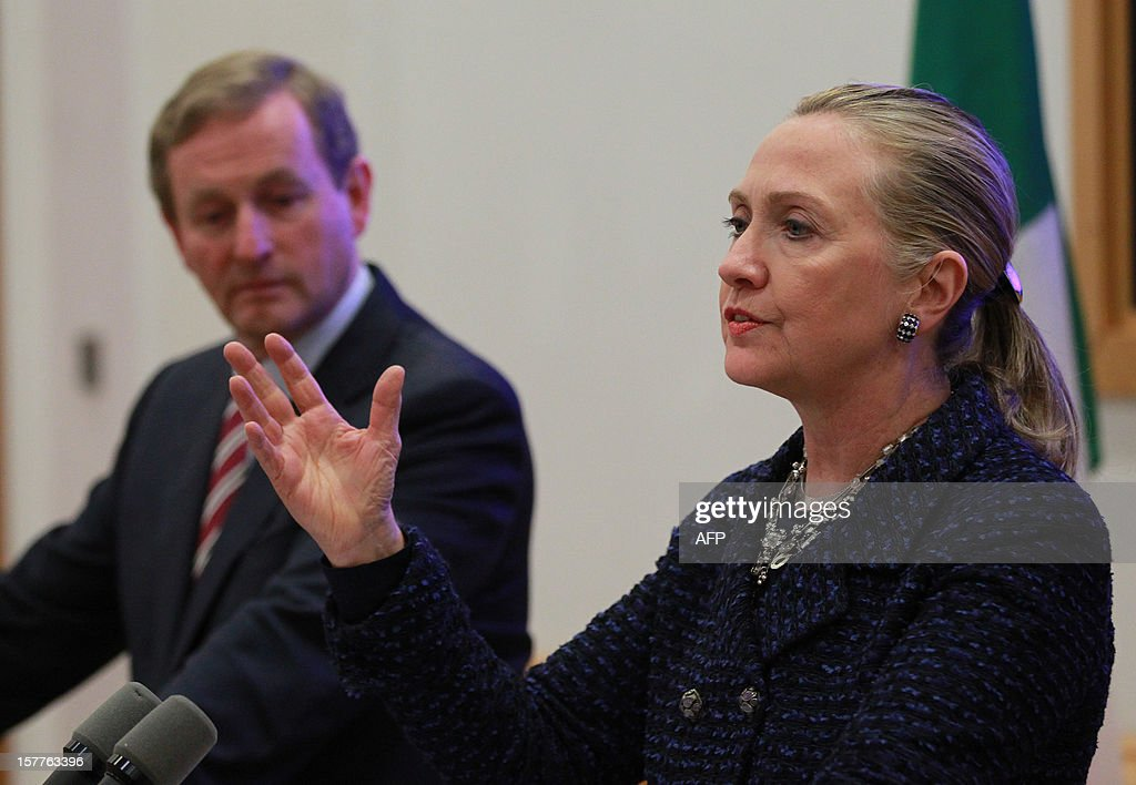 US Secretary of State <a gi-track='captionPersonalityLinkClicked' href=/galleries/search?phrase=Hillary+Clinton&family=editorial&specificpeople=76480 ng-click='$event.stopPropagation()'>Hillary Clinton</a> (R) speaks as Irish Prime Minister Enda Kenny (L) listens during a brief press conference at the Government buildings in Dublin, Ireland on December 6, 2012. Clinton on December 6 issued a sharp warning to European and central Asian nations that some countries were backsliding on democratic values and human rights. AFP PHOTO / PETER MUHLY