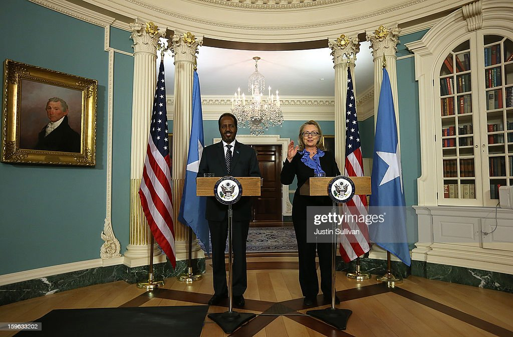 Secretary of State <a gi-track='captionPersonalityLinkClicked' href=/galleries/search?phrase=Hillary+Clinton&family=editorial&specificpeople=76480 ng-click='$event.stopPropagation()'>Hillary Clinton</a> (R) speaks as Somali president Hassan Sheikh Mohamud speaks during a news conference on January 17, 2013 in Washington, DC. Secretary Clinton announced that the United States would recognize the Somali government for the first time in over 20 years, since the shooting down in Mogadishu of two American Black Hawk helicopters.