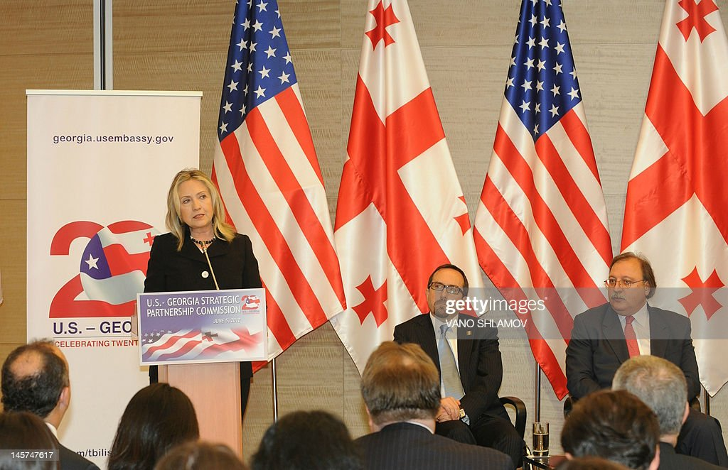 US Secretary of State Hillary Clinton speaks during the opening of the US-Georgia Strategic Partnership Commission in Batumi, Georgia, on June 5, 2012, with Georgian Foreign Minister Grigol Vashadze (R) and US Ambassador to Georgia John Bass (2nd R) attending.