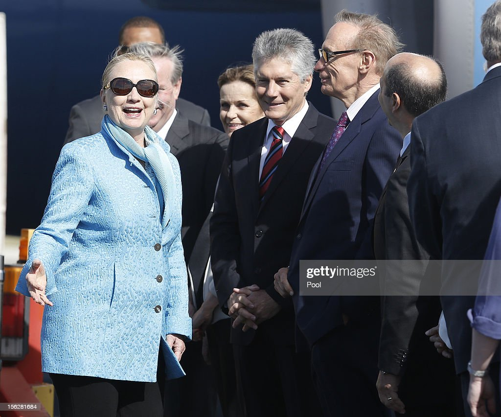 U.S. Secretary of State <a gi-track='captionPersonalityLinkClicked' href=/galleries/search?phrase=Hillary+Clinton&family=editorial&specificpeople=76480 ng-click='$event.stopPropagation()'>Hillary Clinton</a> (L) speaks to Australian Defence Minister Steven Smith (C) and Australian Foreign Minister <a gi-track='captionPersonalityLinkClicked' href=/galleries/search?phrase=Bob+Carr&family=editorial&specificpeople=209391 ng-click='$event.stopPropagation()'>Bob Carr</a> (R) after arriving at Perth International Airport to attend the Australia-United States Ministerial Consultations, on November 13, 2012 in Perth, Australia. The annual AUSMIN (Australia-United States Ministerial Consultations) is held in Perth tomorrow.