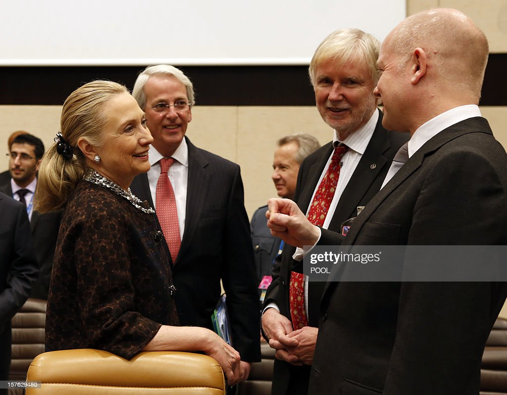 US Secretary of State Hillary Clinton (L) speaks with Finnish Foreign Minister Erkki Tuomioja (2nd R) and British Foreign Secretary William Hague (R) on December 5, 2012 during a meeting with Non-NATO ISAF contributing countries on the second and last day of talks between foreign ministers from the 28 North Atlantic Treaty Organization (NATO) member countries at organization headquarters in Brussels. NATO ministers are to discuss Syria as well as Afghanistan, Russia-NATO ties and the situation in Georgia and the Balkans.
