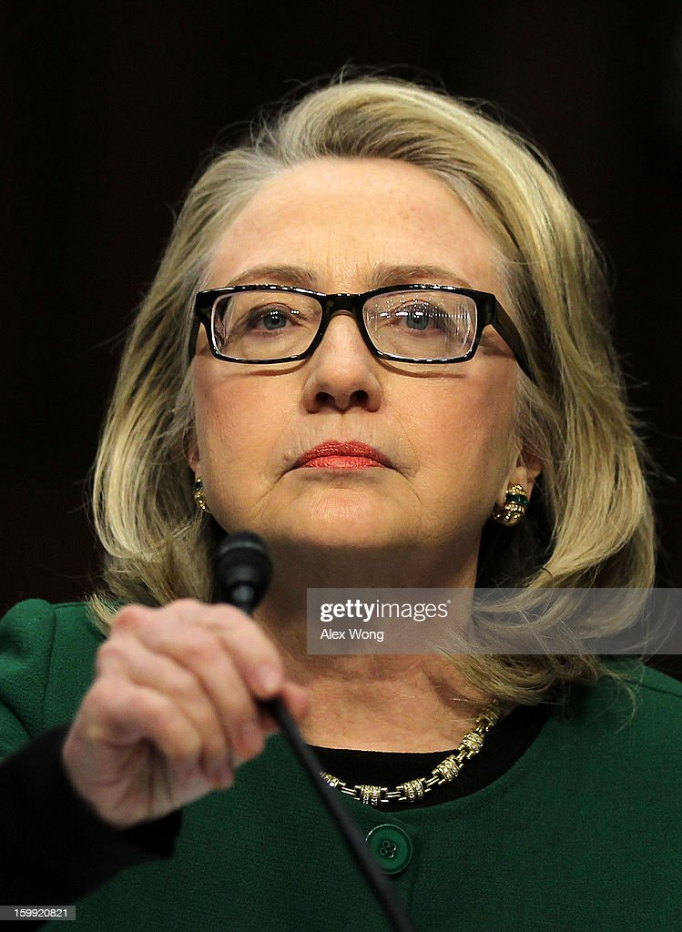 S Secretary of State Hillary Clinton takes her seat prior to a hearing before the Senate Foreign Relations Committee about the September 11 attacks...