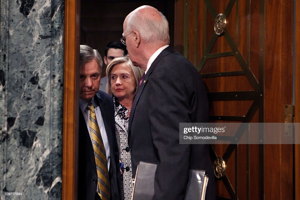 Secretary of State Hillary Clinton (C) talks briefly with Senate Appropriations Subcommittee on State, Foreign Operations, and Related Programs ranking member Sen. Lindsey Graham (R-SC) (L) and Chairman Patrick Leahy (D-VT) before testifying about the department's FY2012 budget on Capitol Hill March 2, 2011 in Washington, DC. Clinton reminded senators that civilians from the State Department will need appropriate budget increases so to take over the U.S. mission in Iraq after the Department of Defense pulls out the last troops at the end of 2011.
