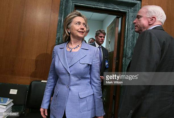 Secretary of State Hillary Clinton talks with Sen John McCain before the start of a Senate Armed Services Committee hearing on Capitol Hill June 17...