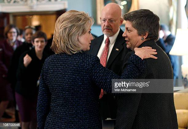 US Secretary of State Hillary Clinton talks with US Director of National Intelligence James Clapper and Homeland Security Secretary Janet Napolitano...