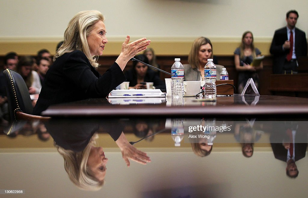 U.S. Secretary of State <a gi-track='captionPersonalityLinkClicked' href=/galleries/search?phrase=Hillary+Clinton&family=editorial&specificpeople=76480 ng-click='$event.stopPropagation()'>Hillary Clinton</a> testifies during a hearing before the House Foreign Affairs Committee October 27, 2011 on Capitol Hill in Washington, DC. Clinton testified on 'Afghanistan and Pakistan: Transition and the Way Forward.'