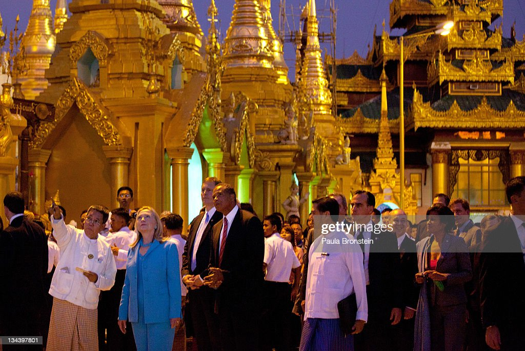 US Secretary of State <a gi-track='captionPersonalityLinkClicked' href=/galleries/search?phrase=Hillary+Clinton&family=editorial&specificpeople=76480 ng-click='$event.stopPropagation()'>Hillary Clinton</a> tours the Shwedagon Pagoda on December 1, 2011 in Yangon, Myanmar. US Secretary of State <a gi-track='captionPersonalityLinkClicked' href=/galleries/search?phrase=Hillary+Clinton&family=editorial&specificpeople=76480 ng-click='$event.stopPropagation()'>Hillary Clinton</a>'s visit, the first official visit to Myanmar (Burma) in over a half a century by a high ranking US representative, comes in the wake of civilian government taking power after almost five decades of rule by military regime. The handover in March 2011 took place after a controlled election under a new constitution that preserved much of the military clout. Clinton is expected to discuss the country's links with North Korea and meet with civil rights figurehead Aung San Suu Kyi.