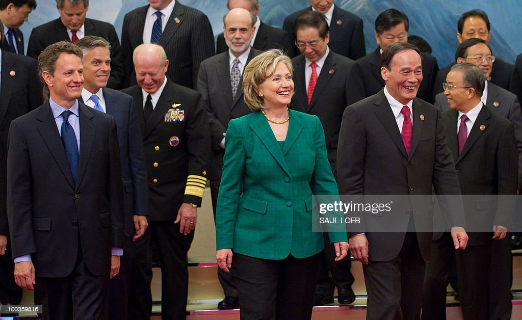 US Secretary of State Hillary Clinton (C), Treasury Secretary Timothy Geithner (L) and Chinese Vice-Premier Wang Qishan (2nd R) leave after posing for a family photo with US and Chinese officials at the Great Hall of the People in Beijing on May 24, 2010, during the start of the second round of the US-China Strategic & Economic Dialogue. The US and China opened two days of high-level talks due to cover a wide range of issues including tensions over the sinking of a South Korean warship, blamed on Pyongyang. AFP PHOTO / POOL / Saul LOEB