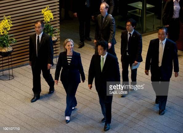US Secretary of State Hillary Clinton walks alongside Japanese Foreign Minister Katsuya Okada as she arrives to attend a meeting with Japanese Prime...