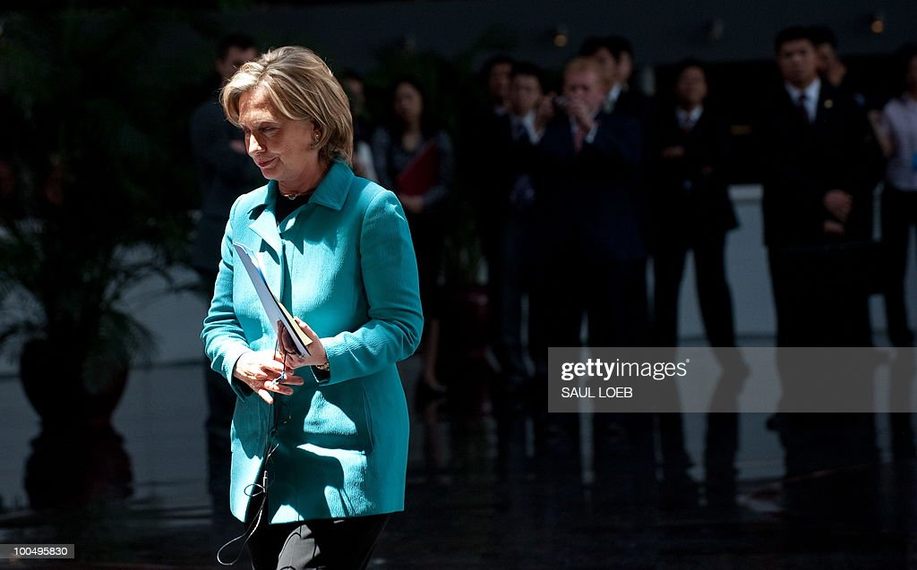 US Secretary of State Hillary Clinton walks to the stage to speak before signing the US-China Consultation on People-to-People Exchange agreement at the National Center for the Performing Arts in Beijing on May 25, 2010. Clinton arrived in Beijing on May 23 ahead of talks with Chinese leaders on trade issues and security threats including renewed tensions on the Korean peninsula. Clinton flew into the capital from Shanghai, where she had toured the World Expo site, and attended a state dinner hosted by Dai Bingguo, a member of China's State Council, or cabinet. AFP PHOTO / POOL / Saul LOEB