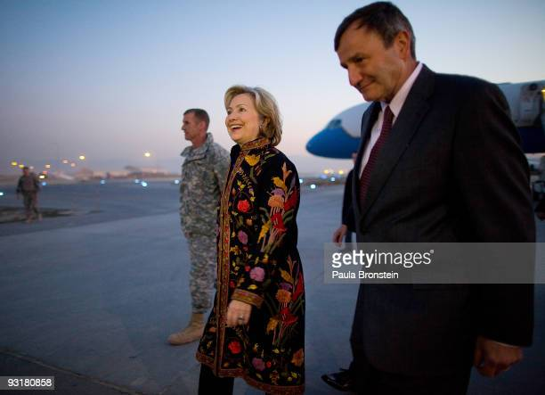 S Secretary of State Hillary Clinton walks with US Ambassador to Afghan Karl Eikenberry after arriving on November 18 2009 in Kabul Afghanistan This...