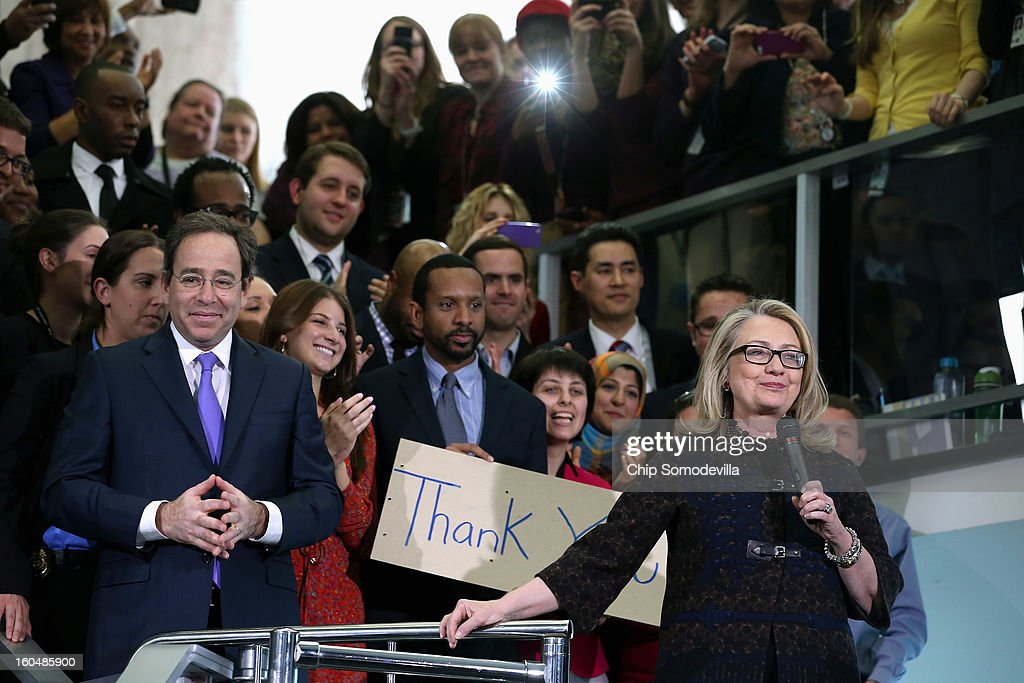 U.S. Secretary of State <a gi-track='captionPersonalityLinkClicked' href=/galleries/search?phrase=Hillary+Clinton&family=editorial&specificpeople=76480 ng-click='$event.stopPropagation()'>Hillary Clinton</a> (R) waves goodbye after delivering her farewell address to the staff with Deputy Secretary of State for Management and Resources Tomas Nides (L) in the C Street lobby of the State Department on February 1, 2013 in Washington, DC. With a strong record in exerting what she called 'soft power,' Clinton is leaving the State Department and the Obama Administration after travling 956,733 miles and visiting some 112 countries.