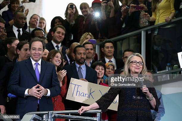 S Secretary of State Hillary Clinton waves goodbye after delivering her farewell address to the staff with Deputy Secretary of State for Management...