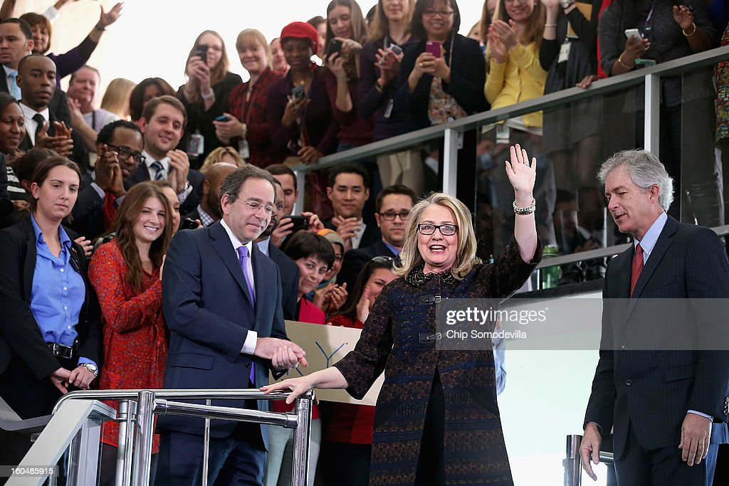 U.S. Secretary of State <a gi-track='captionPersonalityLinkClicked' href=/galleries/search?phrase=Hillary+Clinton&family=editorial&specificpeople=76480 ng-click='$event.stopPropagation()'>Hillary Clinton</a> (R) waves goodbye after delivering her farewell address to the staff with Deputy Secretary of State for Management and Resources Tomas Nides (L) and Deputy Secretary of State William Burns in the C Street lobby of the State Department on February 1, 2013 in Washington, DC. With a strong record in exerting what she called 'soft power,' Clinton is leaving the State Department and the Obama Administration after travling 956,733 miles and visiting some 112 countries.