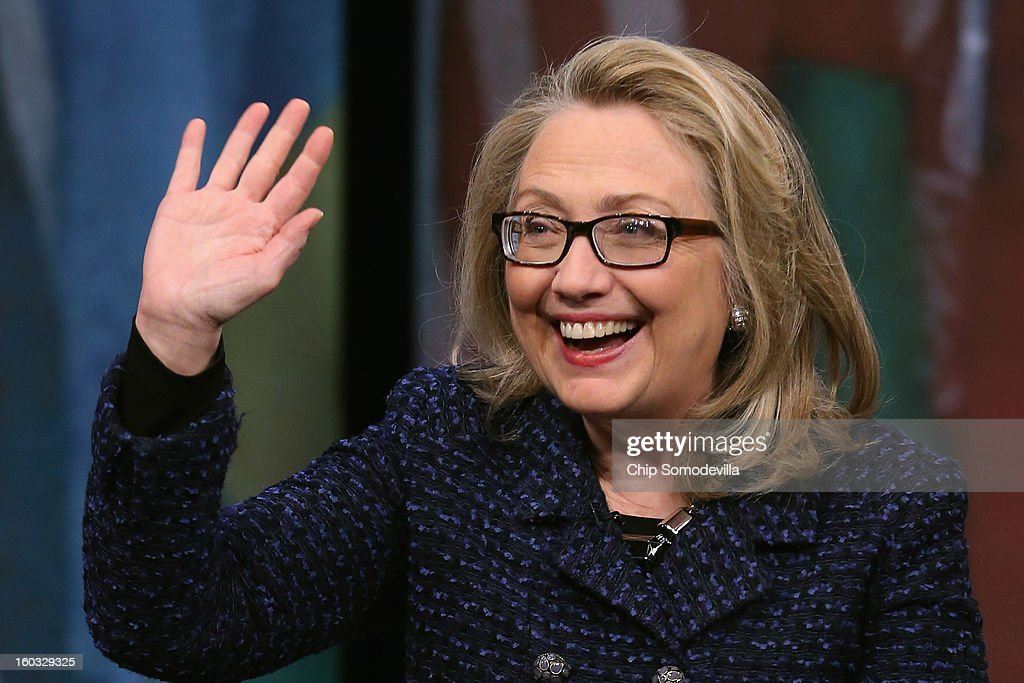 U.S. Secretary of State <a gi-track='captionPersonalityLinkClicked' href=/galleries/search?phrase=Hillary+Clinton&family=editorial&specificpeople=76480 ng-click='$event.stopPropagation()'>Hillary Clinton</a> waves goodbye after holding a 'Global Townterview' at the Newseum January 29, 2013 in Washington, DC. Clinton took questions from youths from around the world via satellite and social media including Twitter, Facebook and Skype in advance of her last day at the State Department Friday.