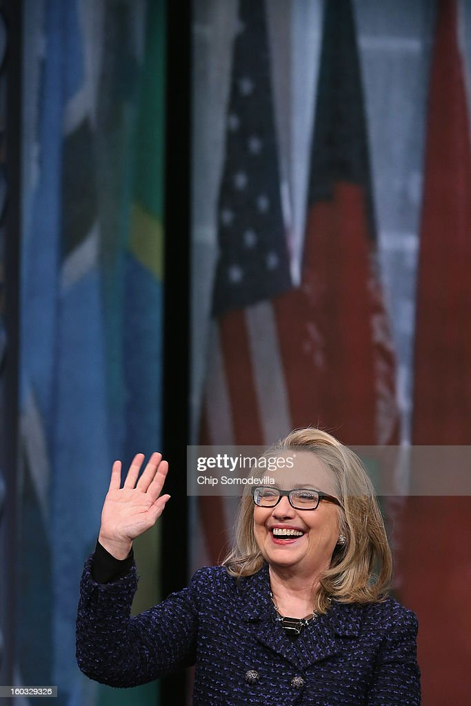 U.S. Secretary of State Hillary Clinton waves goodbye after holding a 'Global Townterview' at the Newseum January 29, 2013 in Washington, DC. Clinton took questions from youths from around the world via satellite and social media including Twitter, Facebook and Skype in advance of her last day at the State Department Friday.