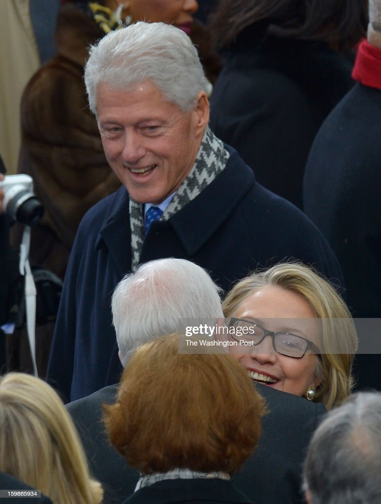 Secretary of State Hillary Rodham Clinton greets former President Jimmy Carter and her husband, Former President Bill Clinton, looks on during the 57th Presidential Inauguration Ceremony at the United States Capitol on Monday, January 21, 2013. President Barack Obama was sworn in for his second term of office.