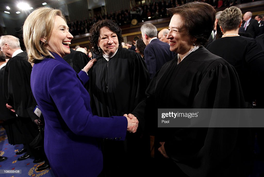 Secretary of State Hillary Rodham Clinton (L) greets Supreme Court Justices <a gi-track='captionPersonalityLinkClicked' href=/galleries/search?phrase=Elena+Kagan&family=editorial&specificpeople=5704239 ng-click='$event.stopPropagation()'>Elena Kagan</a> (R) and <a gi-track='captionPersonalityLinkClicked' href=/galleries/search?phrase=Sonia+Sotomayor&family=editorial&specificpeople=5872777 ng-click='$event.stopPropagation()'>Sonia Sotomayor</a> prior to U.S. President Barack Obama delivering his State of the Union address on Capitol Hill January 25, 2011 in Washington, DC. During his speech Obama was expected to focus on the U.S. economy and increasing education and infrastructure funding while proposing a three-year partial freeze of domestic programs and $78 billion in military spending cuts.
