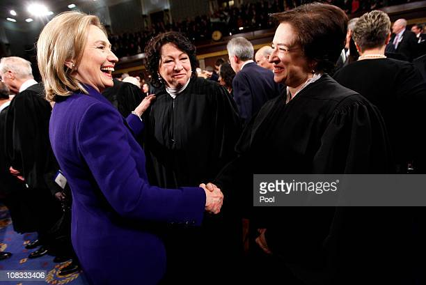 Secretary of State Hillary Rodham Clinton greets Supreme Court Justices Elena Kagan and Sonia Sotomayor prior to US President Barack Obama delivering...