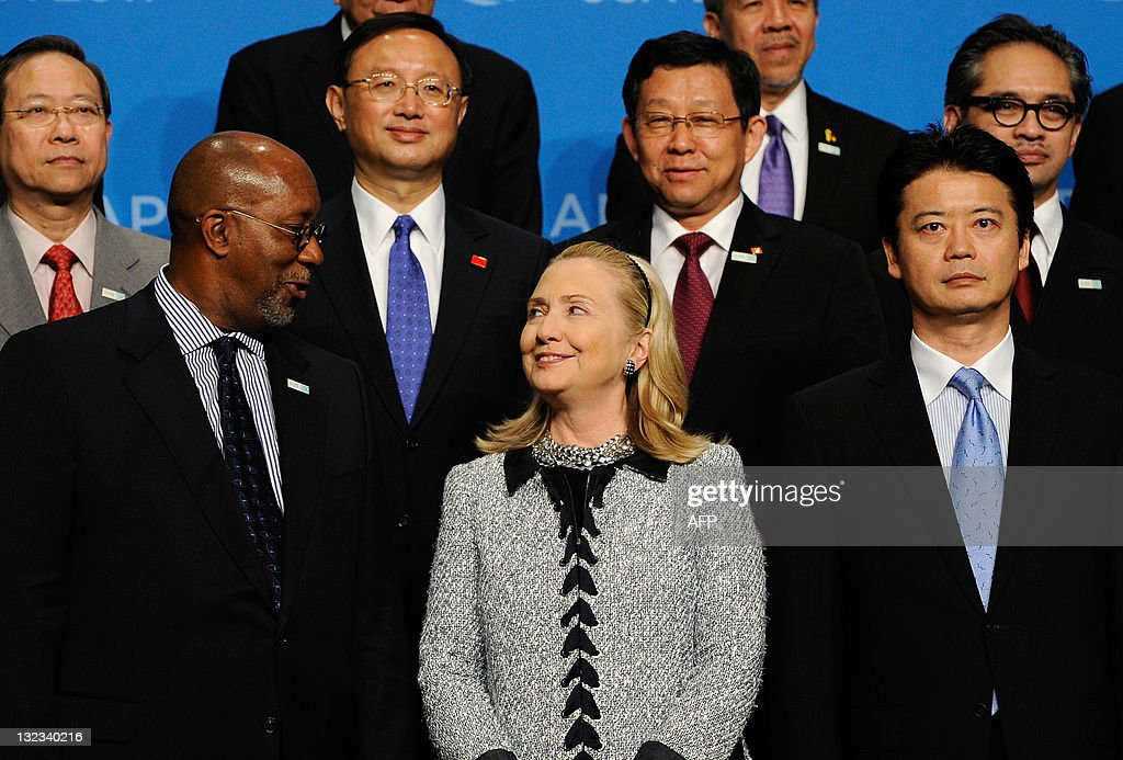 US Secretary of State Hillary Rodham Clinton (C) looks at US Trade Representative <a gi-track='captionPersonalityLinkClicked' href=/galleries/search?phrase=Ron+Kirk&family=editorial&specificpeople=2599926 ng-click='$event.stopPropagation()'>Ron Kirk</a> (L) as they pose with Foreign Minister of Japan <a gi-track='captionPersonalityLinkClicked' href=/galleries/search?phrase=Koichiro+Gemba&family=editorial&specificpeople=7046304 ng-click='$event.stopPropagation()'>Koichiro Gemba</a> (R) and the rest of the APEC Foreign and Tarde Ministers after their Ministerial meeting on November 11, 2011 in Waikiki, Hawaii. The United States is hosting this year's Asia-Pacific Economic Cooperation (APEC) summit, with leaders from the 21 member economies convening on the island of Oahu.