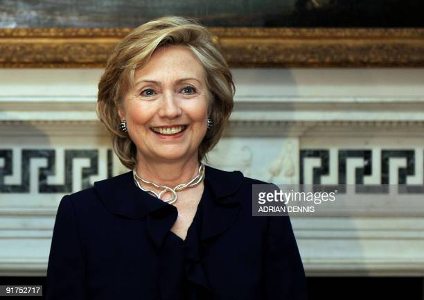 US Secretary of State Hillary Rodham Clinton smiles to the awaiting press upon her arrival at No1 Carlton Gardens to Meet Britain's Foreign Secretary...