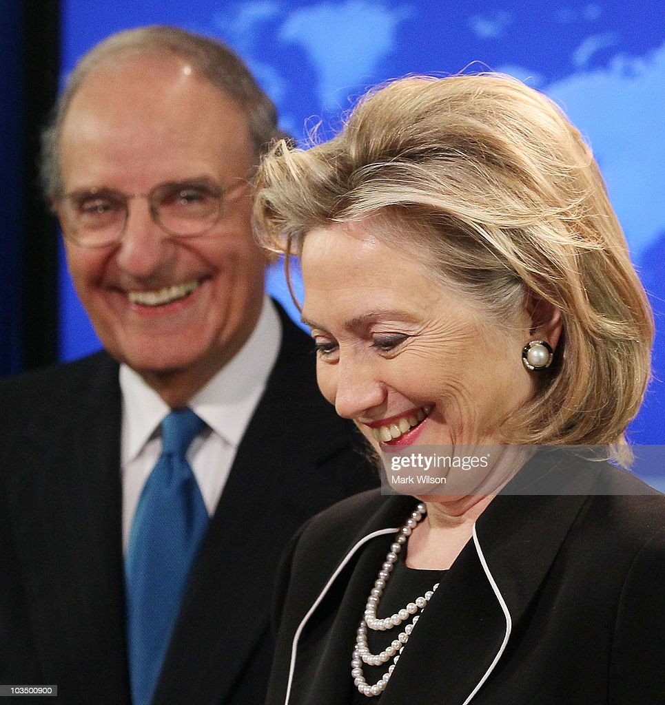 Secretary of State Hillary Rodham Clinton (R) smiles while flanked by Special Envoy for Middle East Peace Talks, Senator George Mitchell (L), while briefing reporters at the State Department on August 20, 2010 in Washington, DC. Secretary Clinton announced that leaders from Israel and Palestine have agreed to participate in peace talks in Washington, DC.