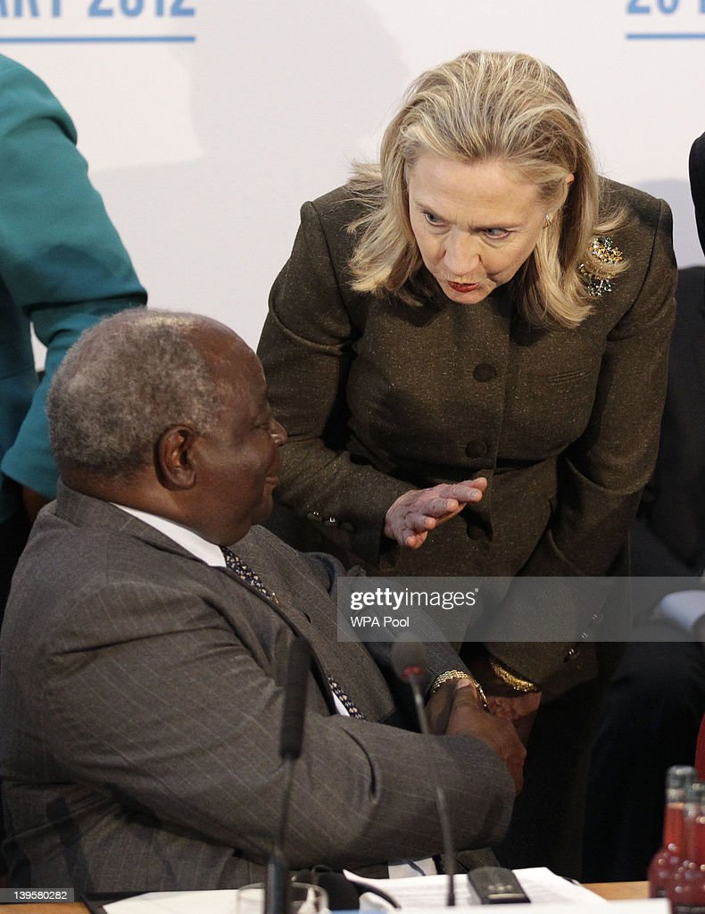 US Secretary of State Hillary Rodham Clinton talks to President of Kenya <a gi-track='captionPersonalityLinkClicked' href=/galleries/search?phrase=Mwai+Kibaki&family=editorial&specificpeople=274745 ng-click='$event.stopPropagation()'>Mwai Kibaki</a> during the Somalia Conference at Lancaster House on February 23, 2012 in London, United Kingdom. Britain's Prime Minister David Cameron has invited US Secretary Of State <a gi-track='captionPersonalityLinkClicked' href=/galleries/search?phrase=Hillary+Clinton&family=editorial&specificpeople=76480 ng-click='$event.stopPropagation()'>Hillary Clinton</a>, UN Secretary General Ban Ki Moon and representatives from over 40 governments to participate in the London Conference on Somalia, to discuss the rebuilding of Somalia and the tackling of piracy, terrorism and famine.