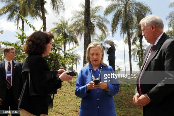 US Secretary of State Hillary Rodham Clinton writes on her cell phone with Roberta S Jacobson US Assistant Secretary of State for Western Hemisphere...