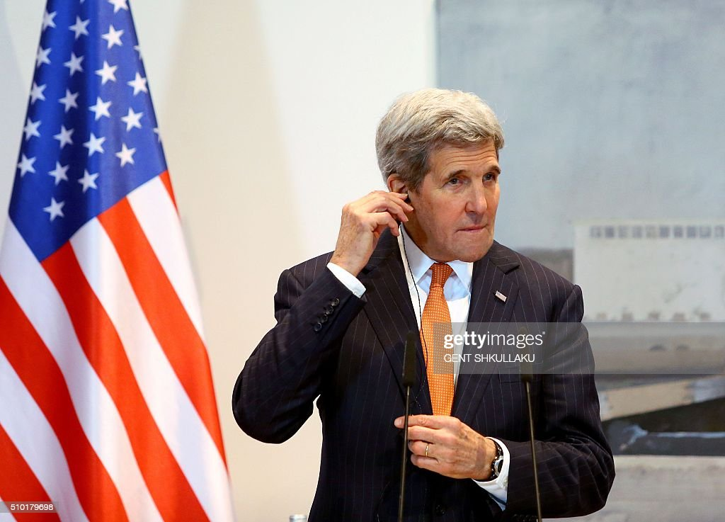 US Secretary of State John Kerry adjusts his earphone during a media statement in Tirana on February 14, 2016. US Secretary of State is in a few hours visit to Tirana, to meet with senior government leaders to discuss Albania's further Euro-Atlantic integration and strong bilateral cooperation with the United States. SHKULLAKU