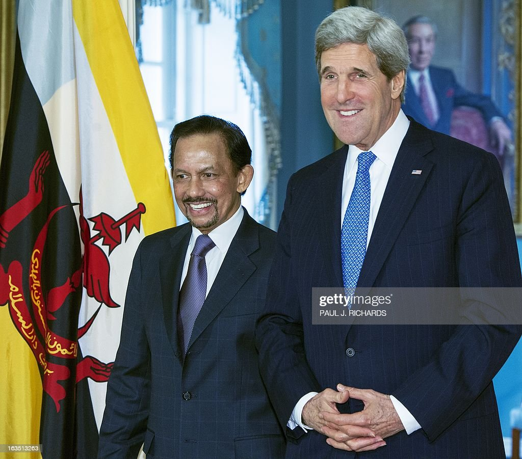 US Secretary of State John Kerry(R) alolng with Sultan of Brunei, Hassanal Bolkiah address the media before a private bilateral meeting March 11, 2013, at the State Department in Washington, DC. AFP Photo/Paul J. Richards