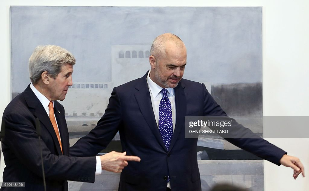 US Secretary of State John Kerry (L) and Albanian Prime Minister Edi Rama (R) leave after speaking during a media statement in Tirana on February 14, 2016. US Secretary of State is in a few hours visit to Tirana, to meet with senior government leaders to discuss Albanias further Euro-Atlantic integration and strong bilateral cooperation with the United States. / AFP / GENT SHKULLAKU