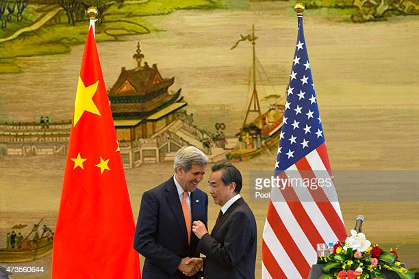 S Secretary of State John Kerry and Chinese Foreign Minister Wang Yi shake hands after a press conference following meetings at the Ministry of...