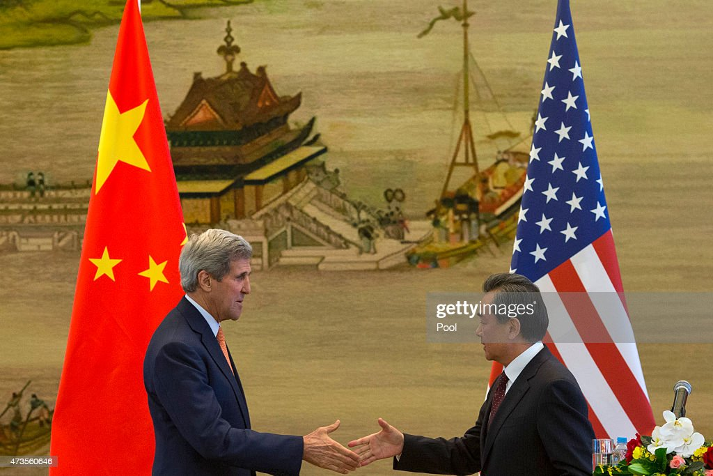 U.S. Secretary of State <a gi-track='captionPersonalityLinkClicked' href=/galleries/search?phrase=John+Kerry&family=editorial&specificpeople=154885 ng-click='$event.stopPropagation()'>John Kerry</a> and Chinese Foreign Minister <a gi-track='captionPersonalityLinkClicked' href=/galleries/search?phrase=Wang+Yi+-+Politician&family=editorial&specificpeople=13620429 ng-click='$event.stopPropagation()'>Wang Yi</a> shake hands after a press conference following meetings at the Ministry of Foreign Affairs on May 16, 2015 in Beijing, China. U.S. Secretary of State <a gi-track='captionPersonalityLinkClicked' href=/galleries/search?phrase=John+Kerry&family=editorial&specificpeople=154885 ng-click='$event.stopPropagation()'>John Kerry</a> is urging China to halt increasingly assertive actions it is taking in the South China Sea.
