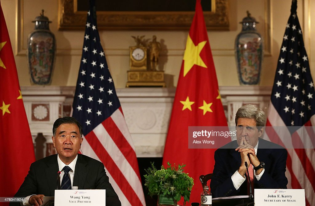 U.S. Secretary of State <a gi-track='captionPersonalityLinkClicked' href=/galleries/search?phrase=John+Kerry&family=editorial&specificpeople=154885 ng-click='$event.stopPropagation()'>John Kerry</a> (R) and Chinese Vice Premier <a gi-track='captionPersonalityLinkClicked' href=/galleries/search?phrase=Wang+Yang+-+Politician&family=editorial&specificpeople=9984662 ng-click='$event.stopPropagation()'>Wang Yang</a> (L) participate in closing statements June 24, 2015 at the Department of State in Washington, DC. Officials from the U.S. and China participated in the seventh annual U.S. Ð China Strategic and Economic Dialogue to discuss bilateral issues.