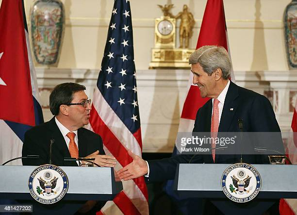 S Secretary of State John Kerry and Cuba's Foreign Minister Bruno Rodriguez shake hands after a news conference at the State Department July 20 2015...