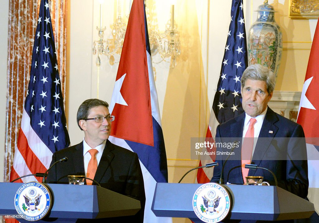 U.S. Secretary of State <a gi-track='captionPersonalityLinkClicked' href=/galleries/search?phrase=John+Kerry&family=editorial&specificpeople=154885 ng-click='$event.stopPropagation()'>John Kerry</a> (R) and Cuba's Foreign Minister Bruno Rodriguez shake attend a news conference at the State Department on July 20, 2015 in Washington, DC. Today the Cuban embassy opened for the first time in 54 years after U.S. President Dwight Eisenhower severed diplomatic ties with the island nation after Fidel Castro took power in a Communist revolution.